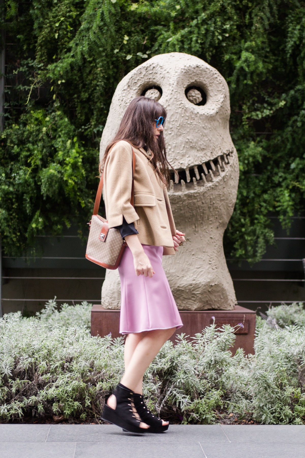 Camel coat and pink skirt.