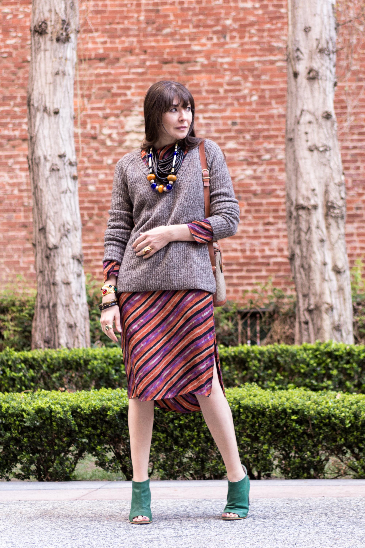 Silk dress and chunky sweater.