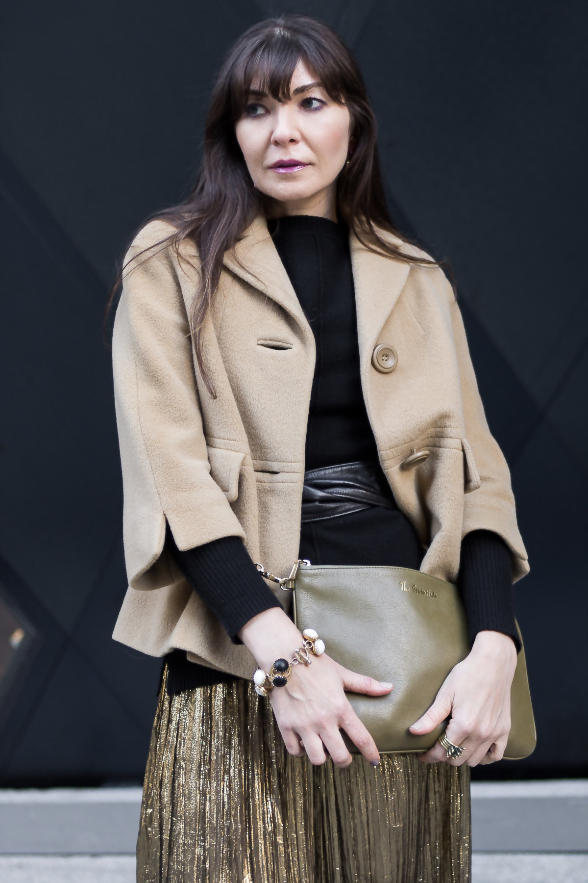 Lamé pleated dress and camel coat for day.
