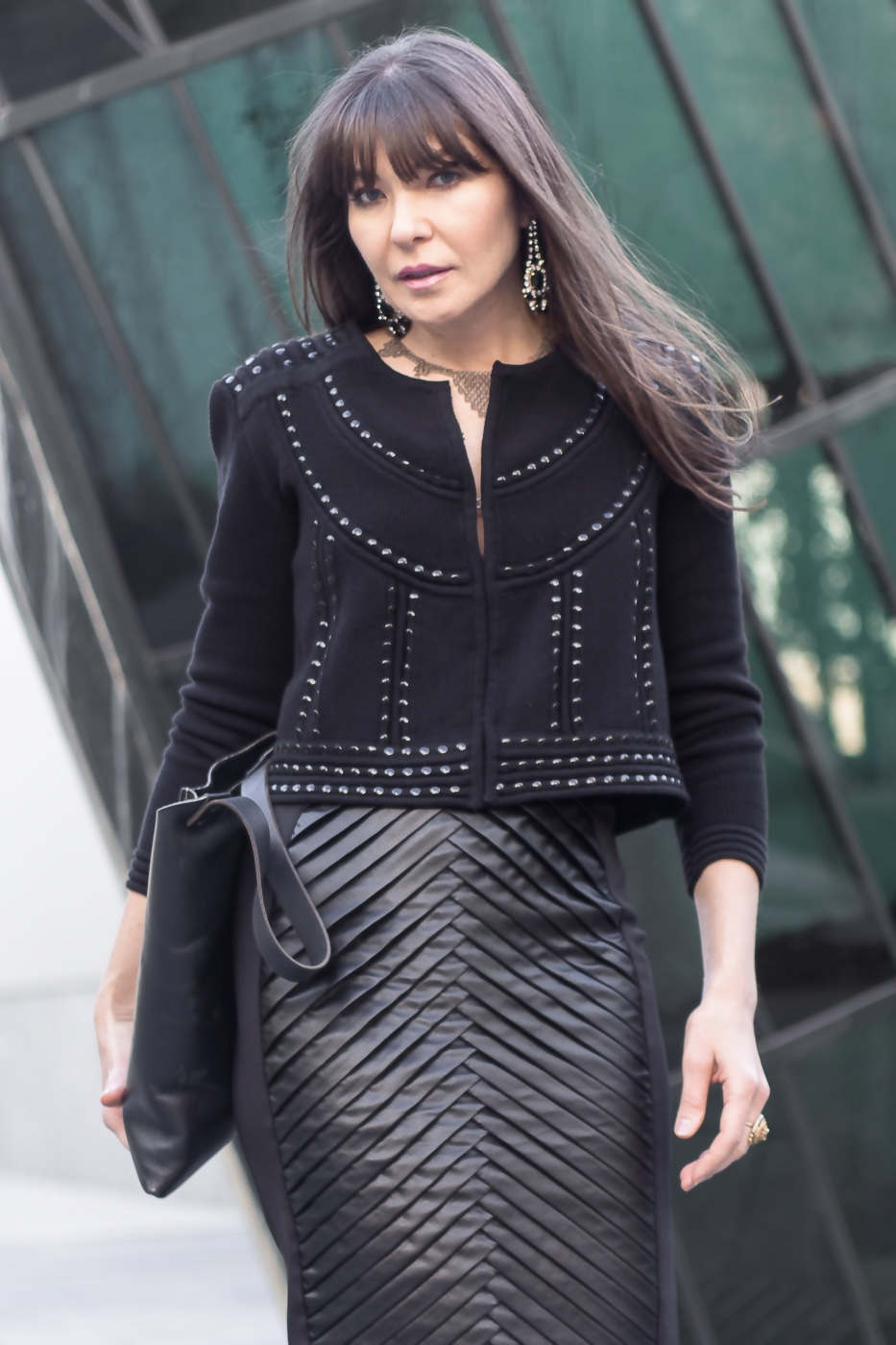 Mahsa leather skirt and Sasha Maks Vintage earrings.