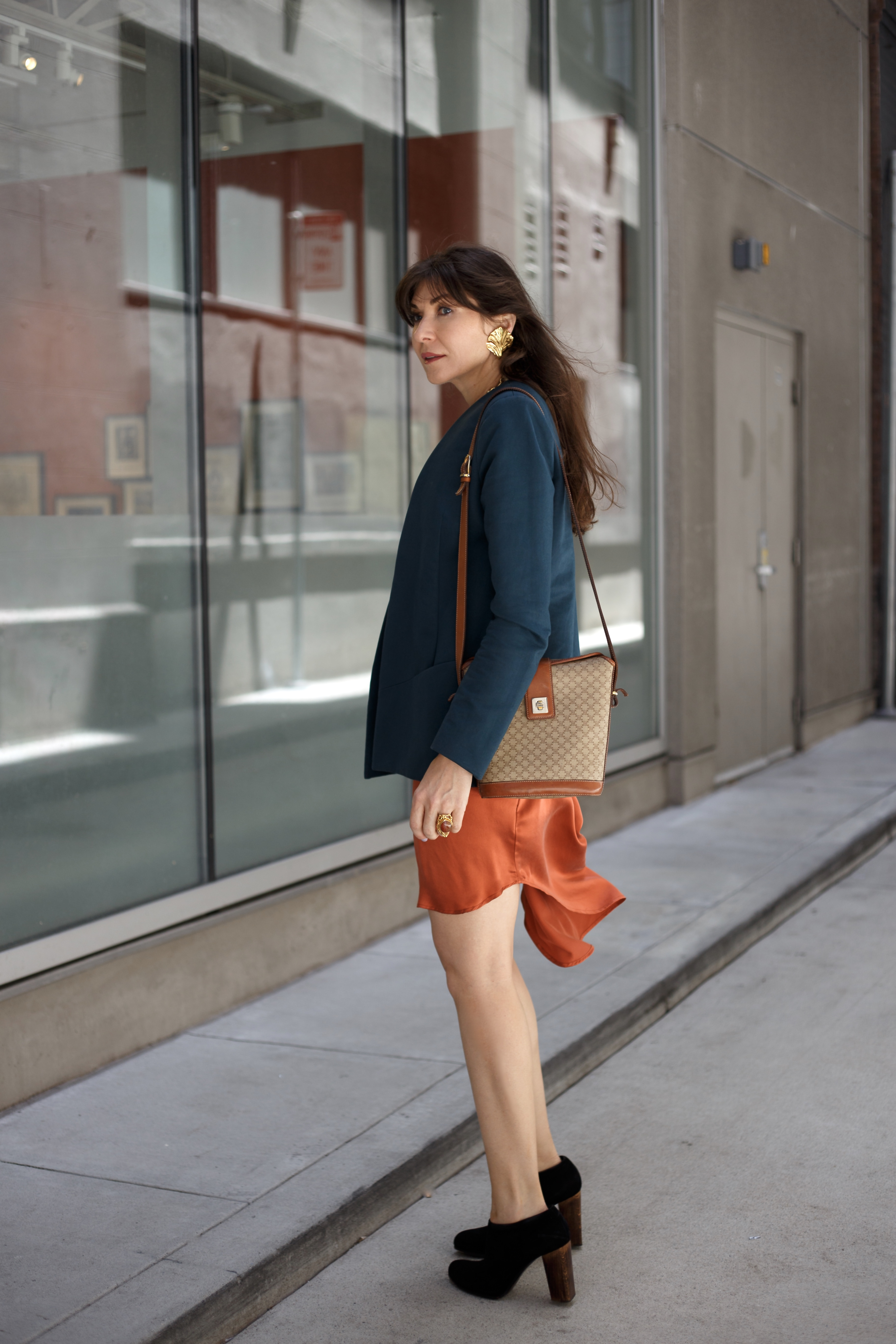 Spring uniform: rust dress and teal blazer.