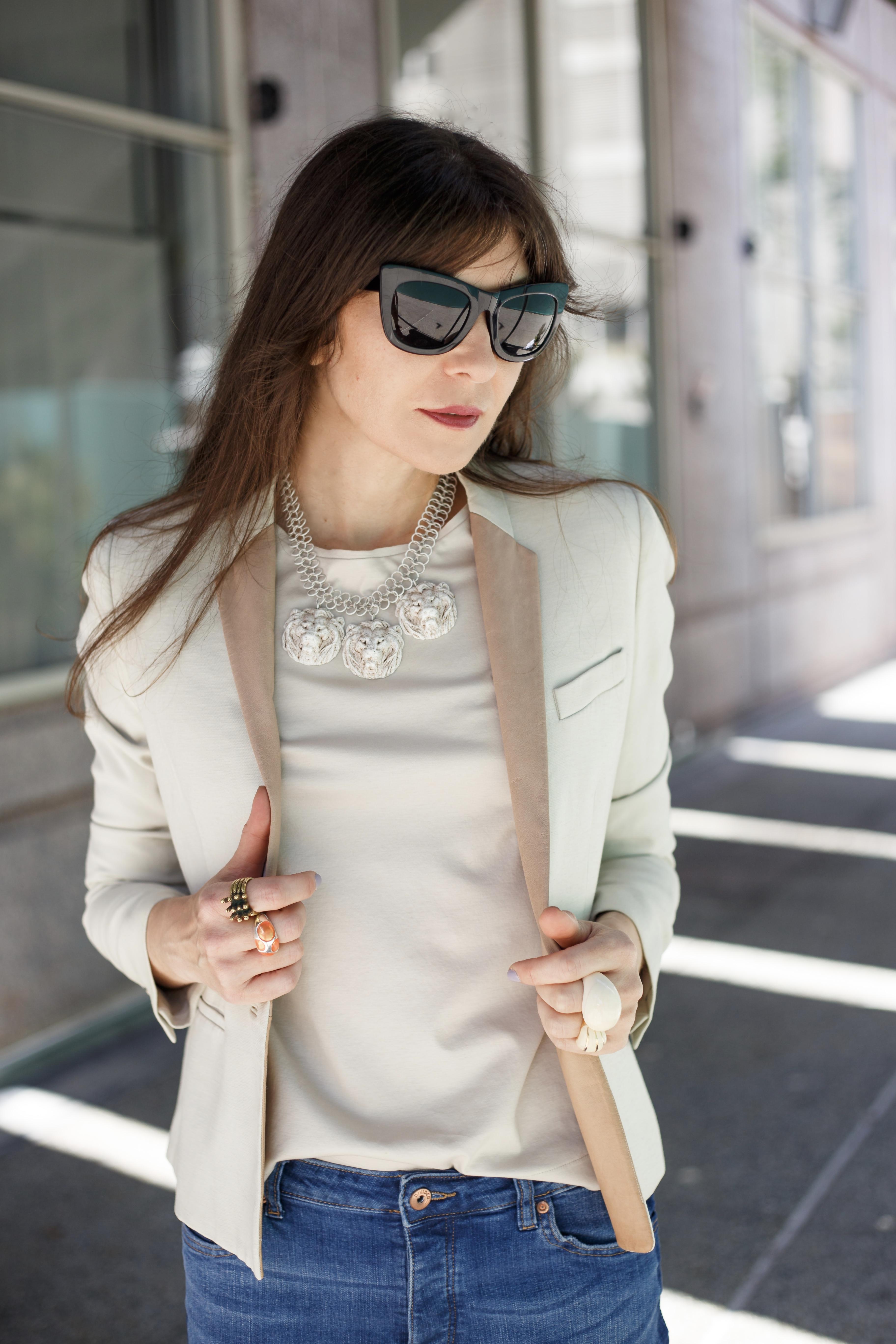 Tuxedo jeans and white blazer.