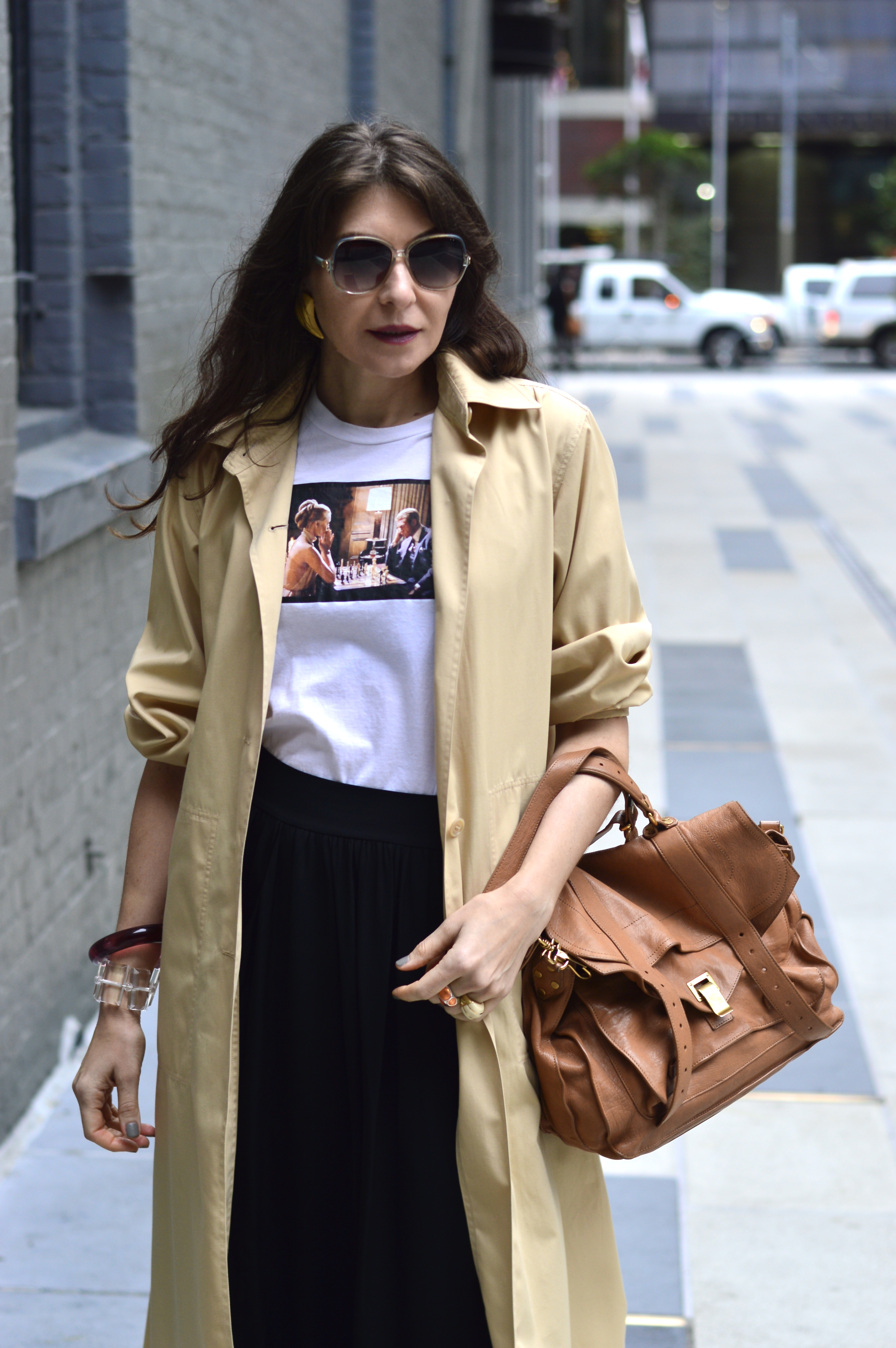 Graphic tee and Courreges duster.