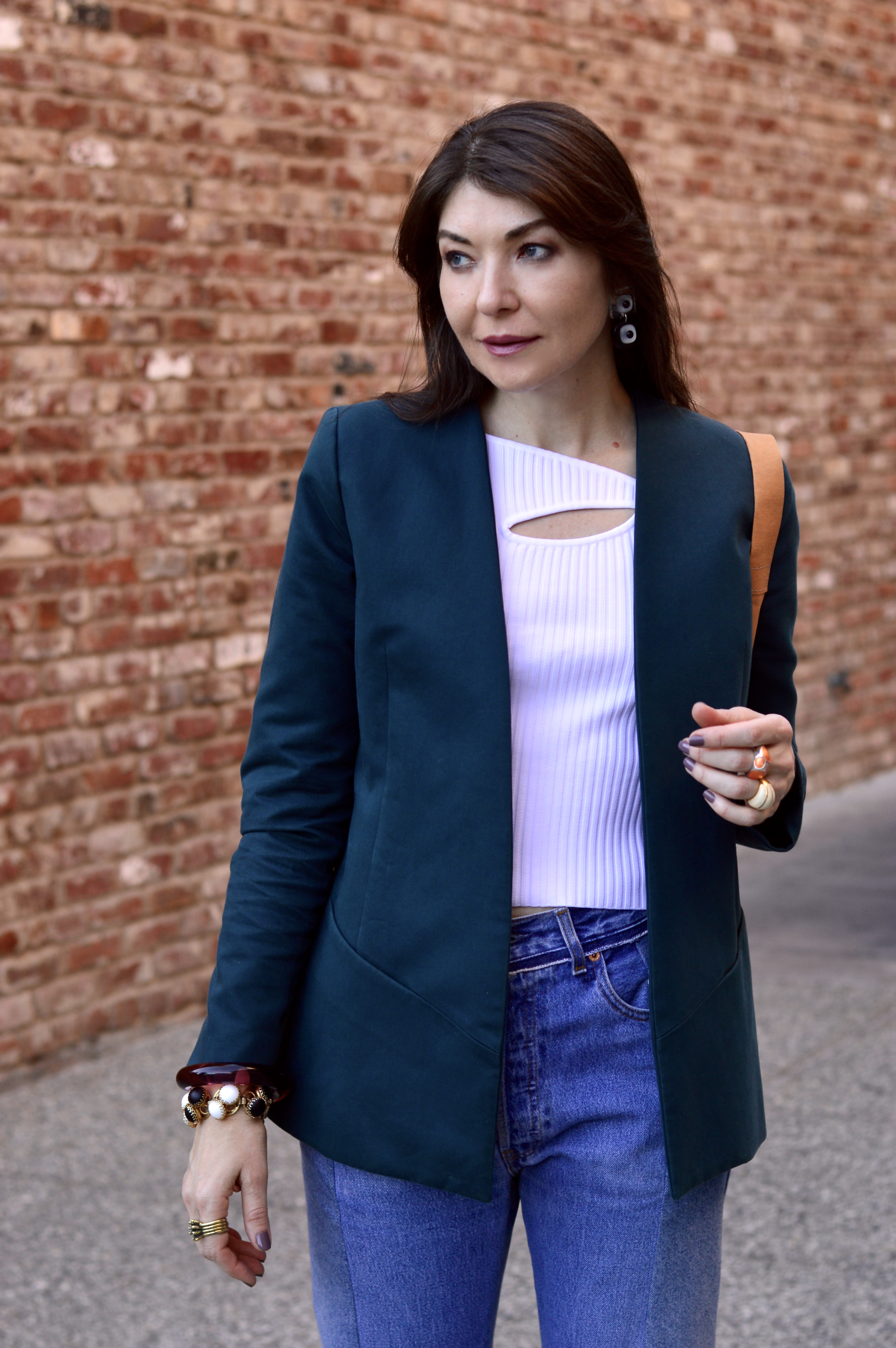 Jeans and cut-out top.