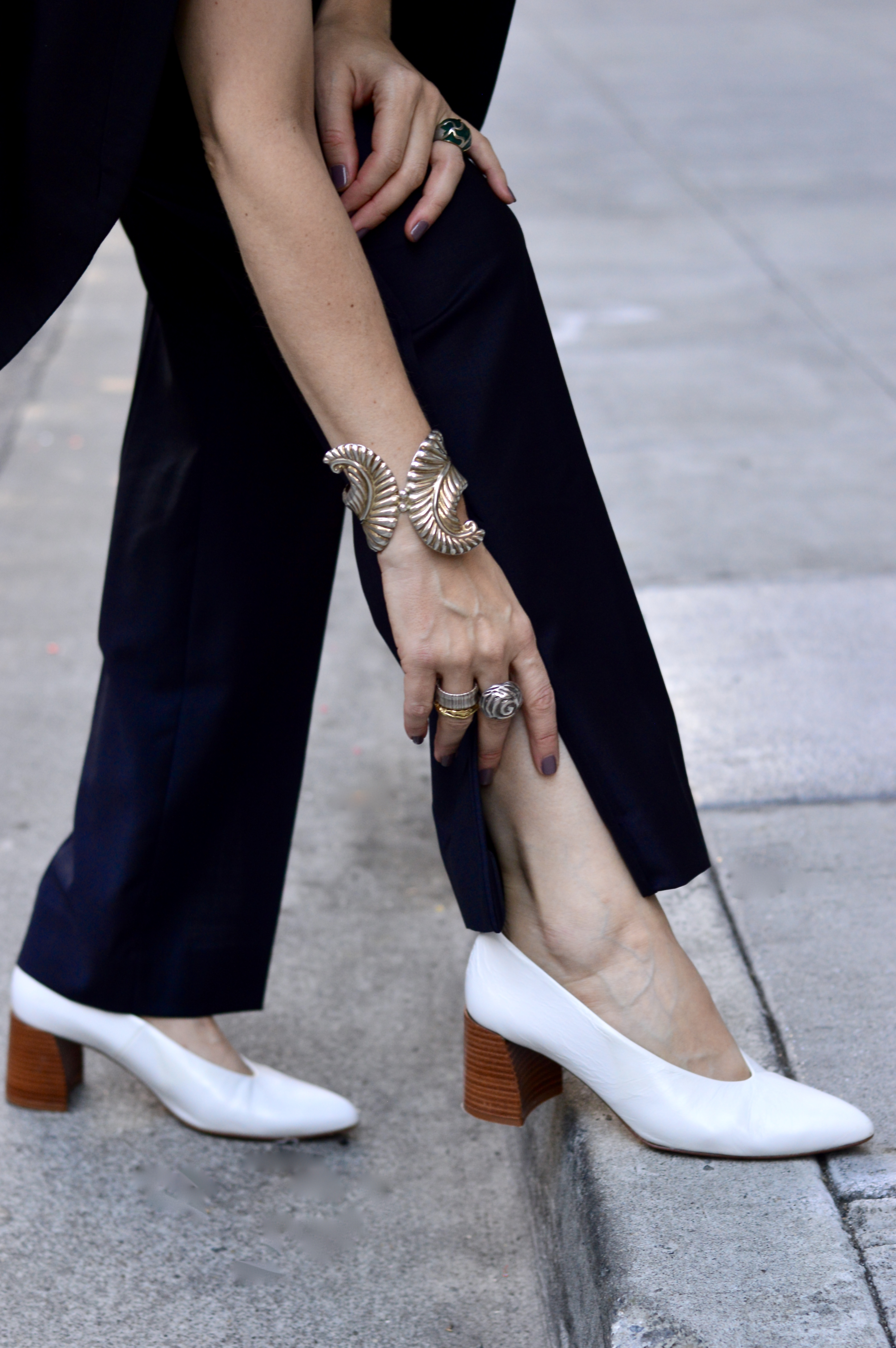 Slit pant suit and statement jewelry