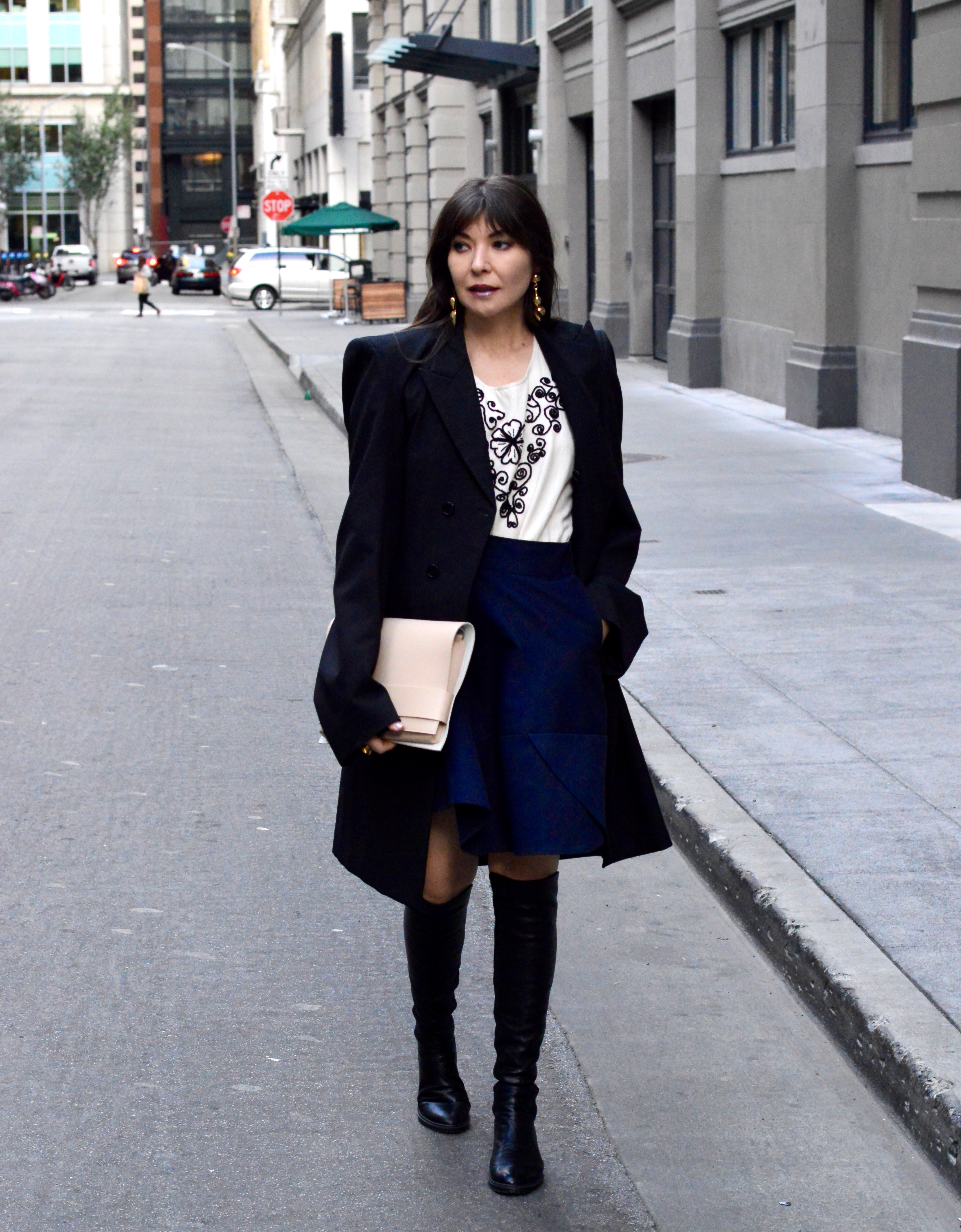 Oversized coat and peasant blouse.