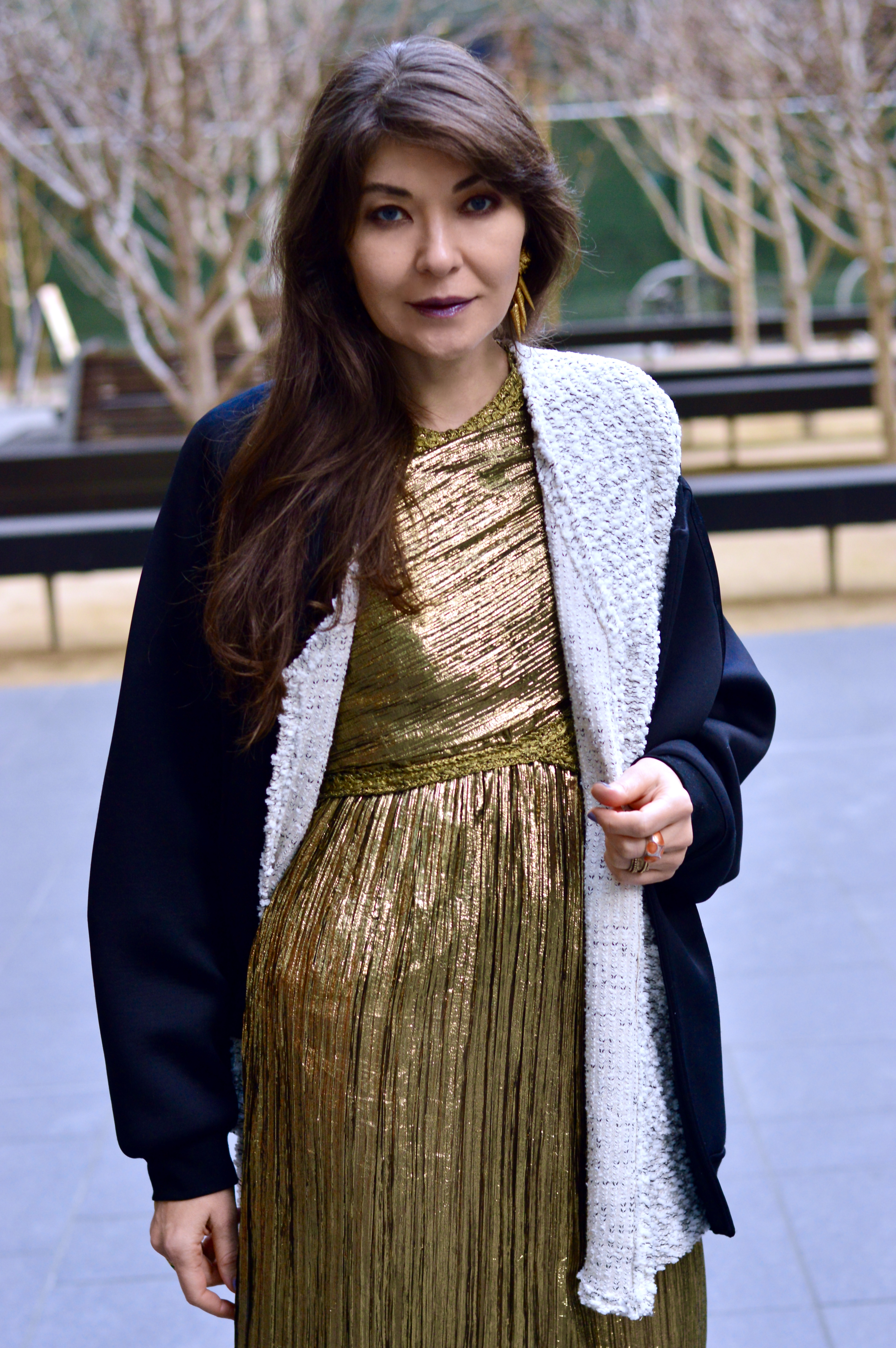 Gold lamé dress and cardigan.