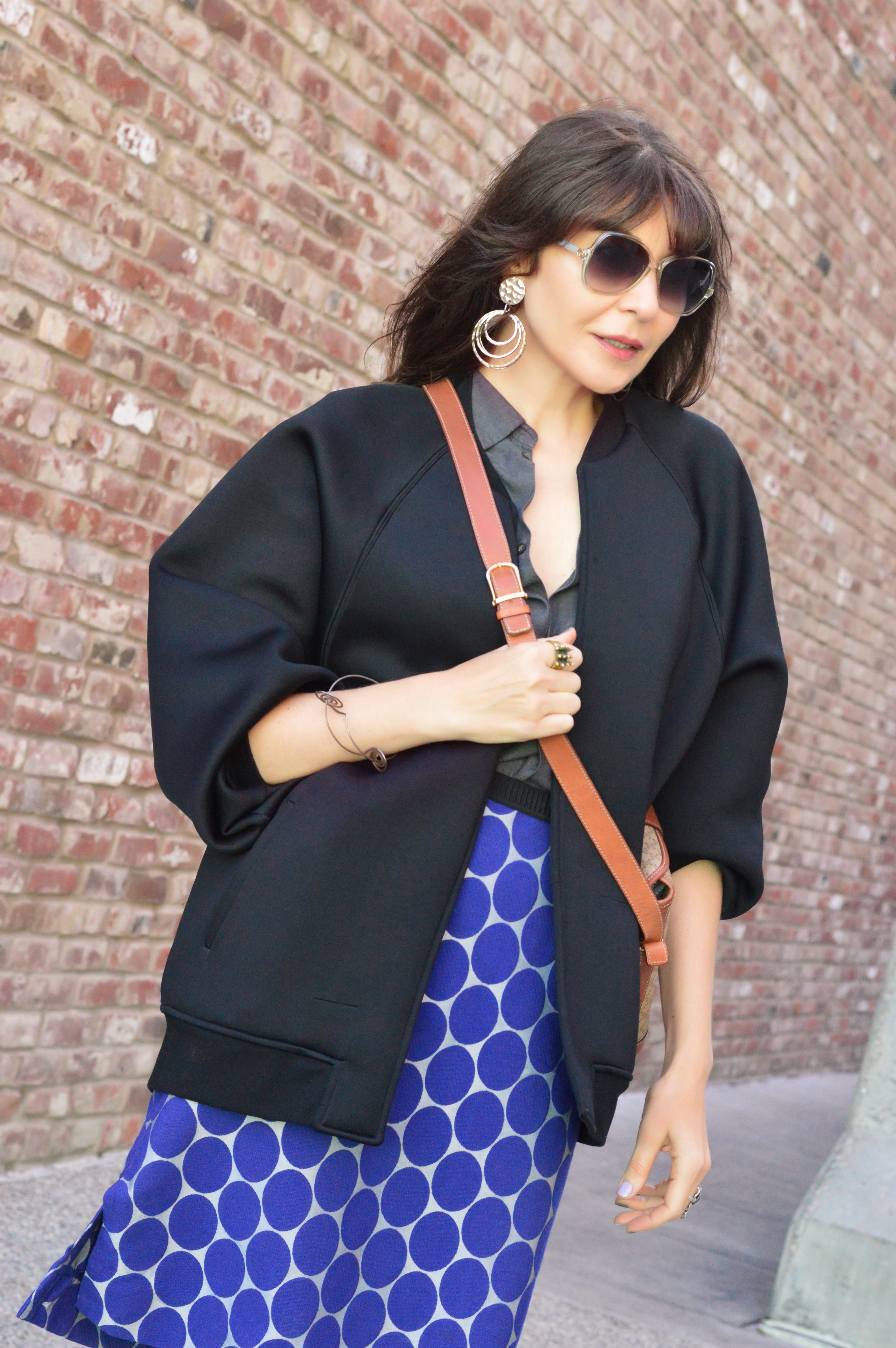 Bomber jacket and polka-dot skirt.